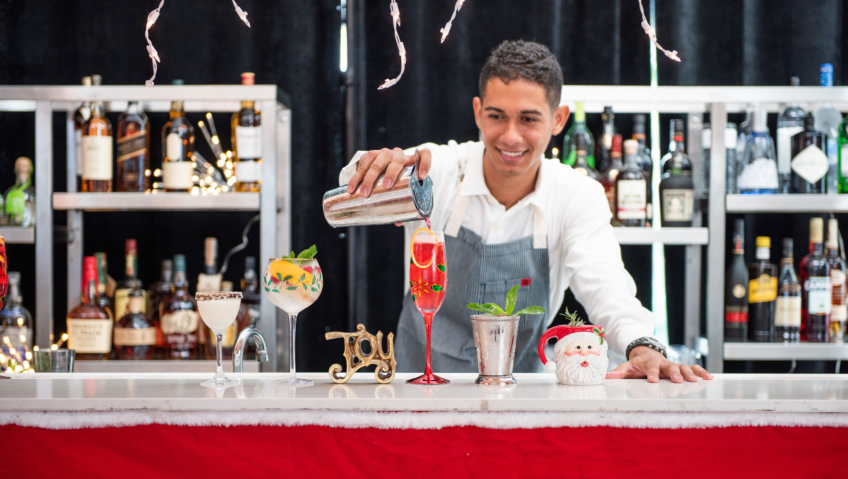 Bartender at Gingerbread Bar pouring a drink
